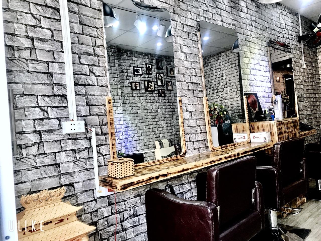 Thi công giấy dán tường tiệm tóc